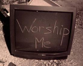 A TV-Set With an Inscription Worship Me